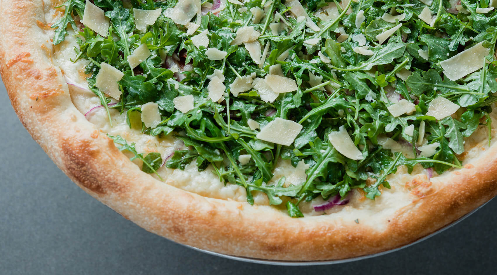 Dewey's Pizza Seasonal Arugula Prosciutto Pizza